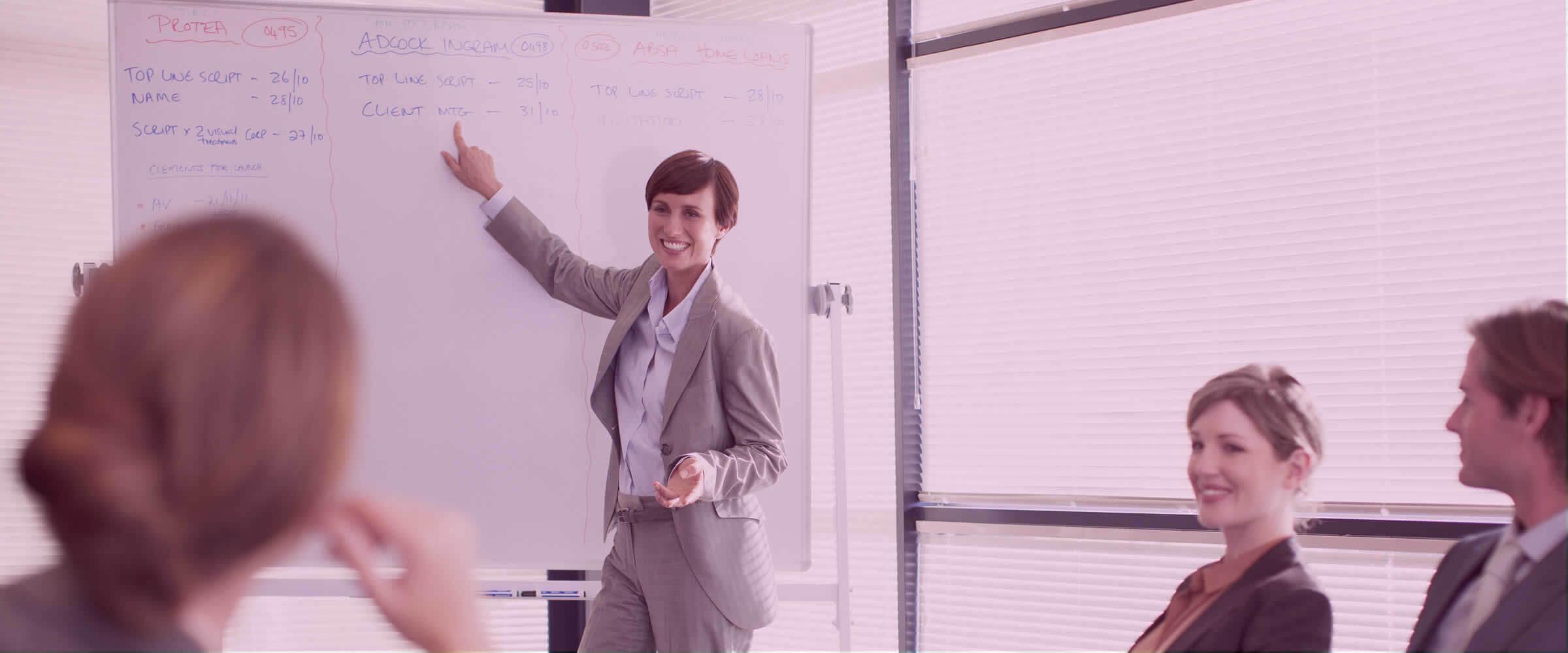 Woman teaching at whiteboard